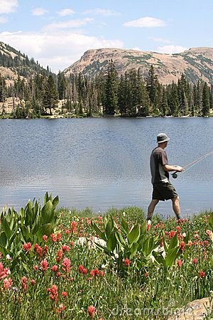 Fisherman walking by lakeside