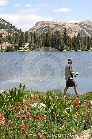 Fisherman walking by lakeside