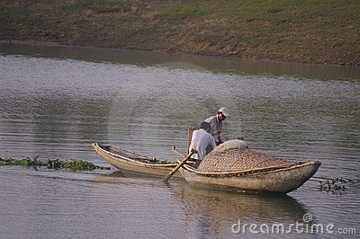 Fishermen in bamboo boats on the lake  Editorial Image