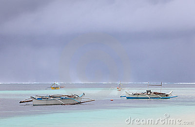 Fishermen boats in tropical storm
