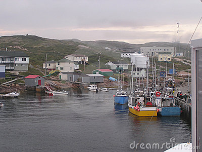 Fishermen boats and village
