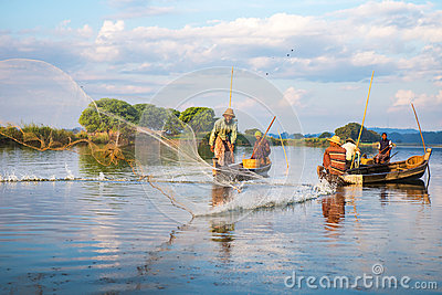 Fishermen catch fish December 3, 2013 Editorial Stock Image