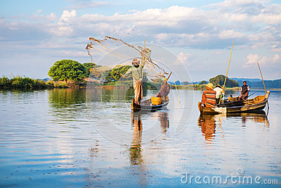 Fishermen catch fish December 3, 2013 in Mandalay. Editorial Image