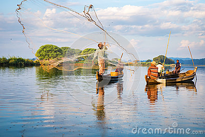 Fishermen catch fish December 3 Editorial Stock Image