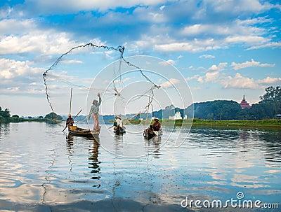Fishermen catch fish December 3, 2013 in Mandalay