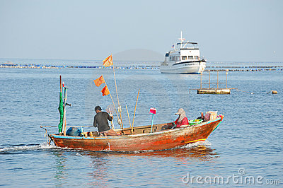 Fishermen fishing on the sea. Editorial Stock Image