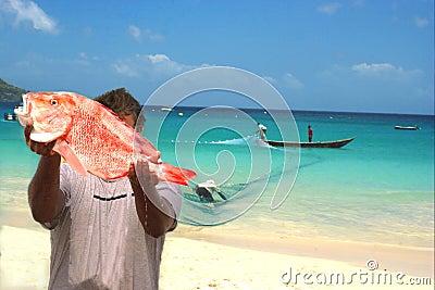 Fishermen, fresh fish & net. Tropical beach.