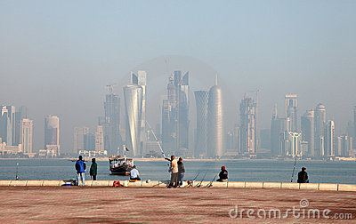 Fishermen in front of Doha skyline Editorial Image