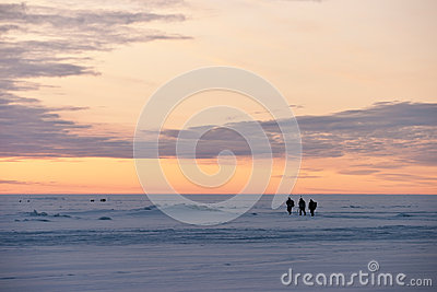 Fishermen on a frozen lake