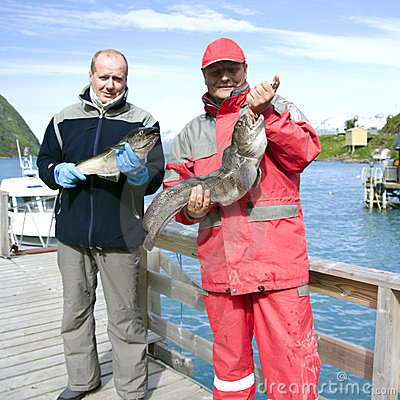 Fishermen holding fish