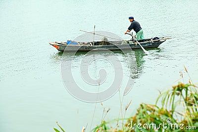 Fishermen on little boat