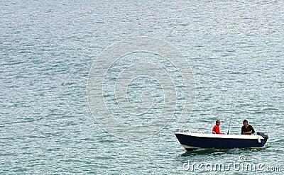 Fishermen in motorboat