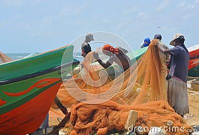 Fishermen at Negombo fish market (Sri Lanka) Editorial Photo