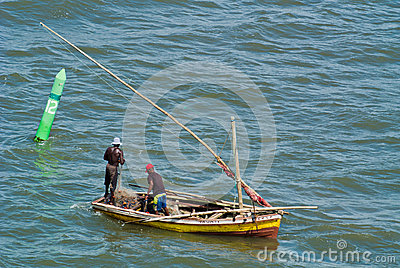 Fishermen and nets in dhow Editorial Photo