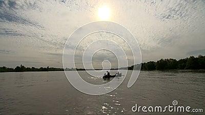 Fishermen releasing fishing net in Danube delta stock footage