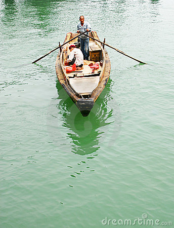 Fishermen rowing in a sampan Editorial Photography