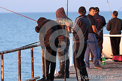 Fishermen at Skorpilovski bridge, Bulgaria Editorial Stock Photo