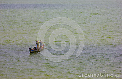 Fishermen at work on a boat