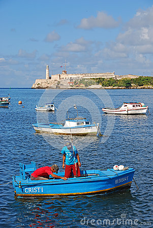 Free Fishermen Working On A Small Blue Boat With Morro Castle In The Background Stock Image - 80083891