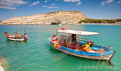 Fishing boat anchored in Matala bay, Crete