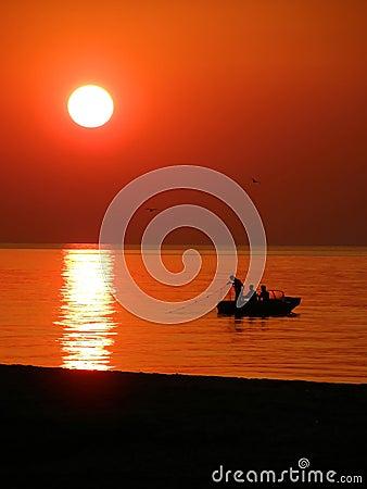 Free Fishing Boat At Sunset Stock Image - 6331921