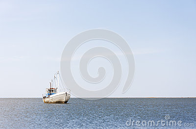 Fishing boat in the blue sea