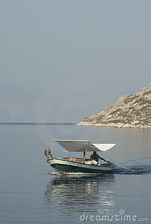 Fishing boat on the calm sea