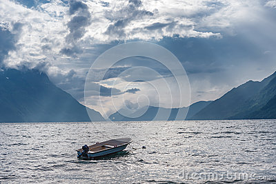 Fishing boat floating on water on fjord