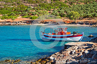 Fishing boat at idyllic beach on Crete