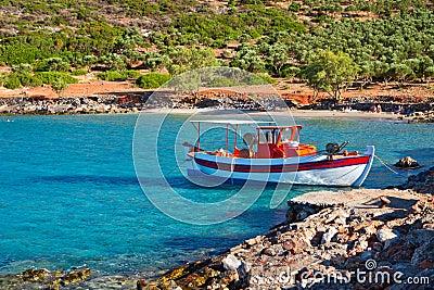 Fishing boat at idyllic beach on Crete