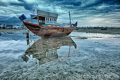 Fishing boat during low tide