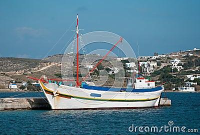 Fishing boat at marina on the island