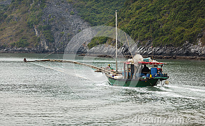 Fishing boat with net in halong bay vietnam royalty free for 21 iceboat terrace for sale