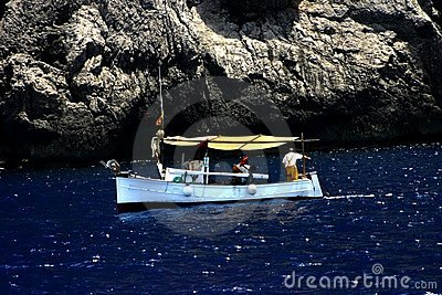 Fishing boat and rocky coast