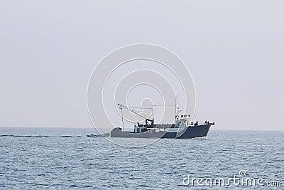 Fishing boat sailing at sea
