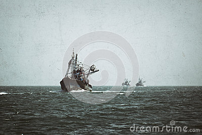 A fishing boat is at sea fishing. Stock Photo