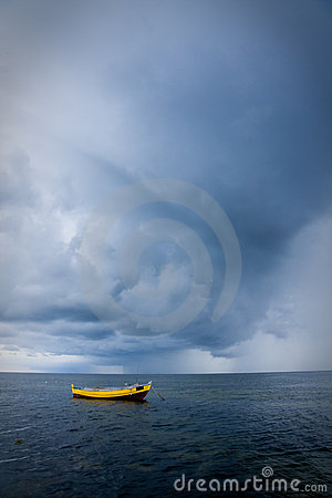 Fishing boat in stormy sea