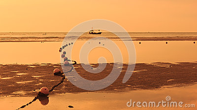 Fishing boat and sunset.