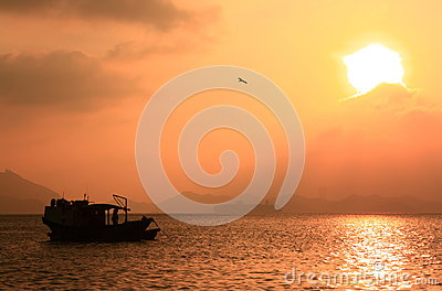Fishing boat in sunset, Hong Kong.
