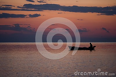 Fishing boat in a sunset light
