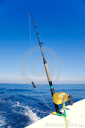Free Fishing Boat Trolling In Ocean With Golden Reel Stock Image - 21470591