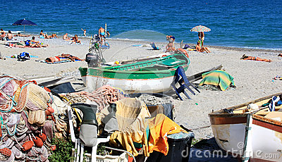 Fishing boats and bathers, Noli, Italian Riviera Editorial Stock Image