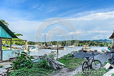 Fishing boats in dock area, Livingston, Guatemala Editorial Stock Photo