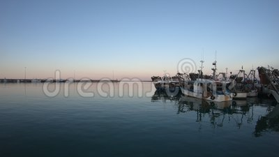 Fishing boats at the end of the day, harbour of San Benedetto del Tronto, Italy. Late afternoon spring day, view of harbour`s entrance of San Benedetto del stock video footage
