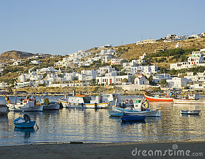 Fishing boats in the harbor of Mykonos at sunset