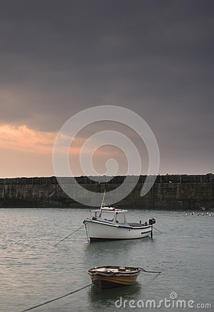 Fishing boats in harbour at sunrise