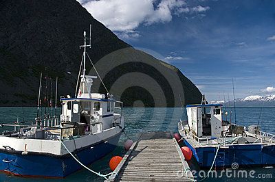 Fishing boats moored at dock