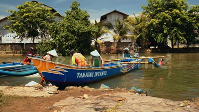 Fishing boats moored at river bank in Cilacap, Java, Indonesia. On sunny summer day stock video