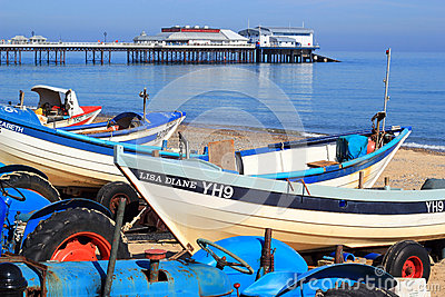 Fishing boats and pier, Cromer. Editorial Photography