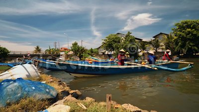 Fishing boats sailing in river in Cilacap, Java, Indonesia. On sunny summer day stock video